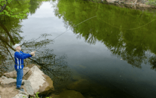 Man fishing in Saco River